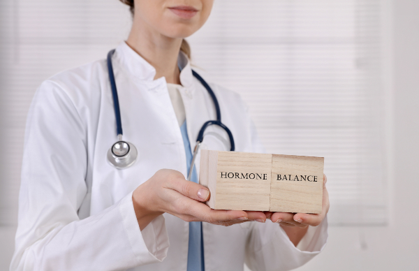 doctor holding wooden blocks that say hormone imbalance